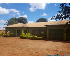 HOUSE FOR SALE ALONG M1 ROAD OPPOSITE WAKAWAKA