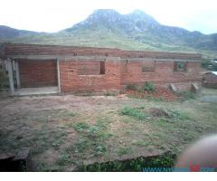 UNIFINISHED HOUSE FOR SALE IN AREA 9 MACHINJIRI